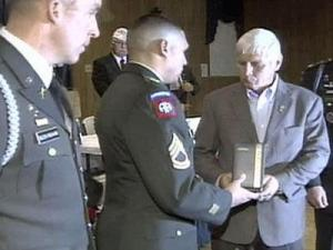 Ronnie Moore accepts the prestigious Silver Star medal for his son, Staff Sgt. William Clint Moore.