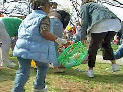 A girl runs to find Easter eggs in Moore Square Park at Raleigh's self-advertised biggest and best Easter egg hunt on Saturday, March 22, 2008.