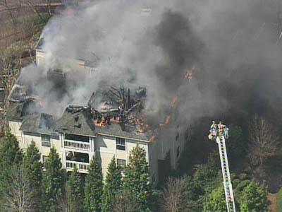 Firefighters battle a fire at a building at the Concord Apartments complex in northwest Raleigh.