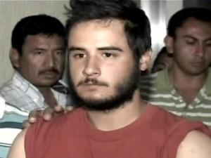 Mexican authorities present fugitive Marine Cesar Laurean to the media after his arrest Thursday, April 10, 2008.