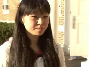 Grace Wang, 20, intervened when a pro-Tibet vigil was met with a counter-protest on the college campus. Wang stepped in, trying to make the two sides talk.