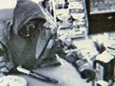 Surveillance footage of an armed robbery at a Kangaroo Express gas station along U.S. Highway 70 in Wayne County on April 18, 2008. Police suspect Anthony Jerome Lee, 39, of Goldsboro, in this robbery, but he had not been charged on April 24, 2008.