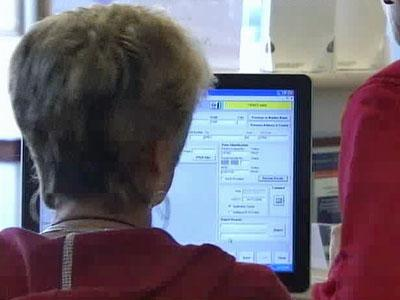 Wake County's Board of Elections workers check each voter registration.