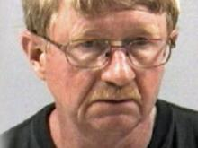 Retired Pharmacist Charged With Peeping