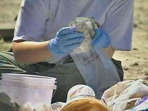 An investigator goes through evidence found at home, at 8130 U.S. Highway 421 in Clinton, suspected of being used as meth lab on Friday, April 25, 2008.