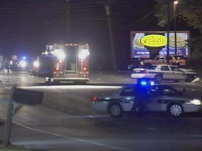A fire rescue truck provides lights for Durham police officers and sheriff's deputies investigating the crash scene on U.S. 70 on April 29, 2008.