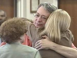 Former lawyer John McCormick hugs family and friends after being sentenced to prison for embezzlement on May 1, 2008.