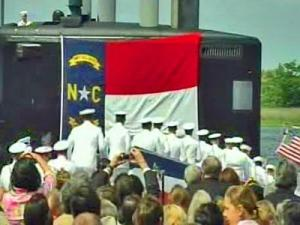 "At the cry of ""Bring her to life!"", 140 sailors rushed onto the newly commissioned USS North Carolina submarine at Wilmington's port on May 2, 2008."