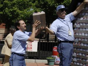 Postal workers load up a truck with food donated during the 15th annual Stamp Out Hunger Drive in 2007. (Photo courtesy of www.stampouthunger.info.)