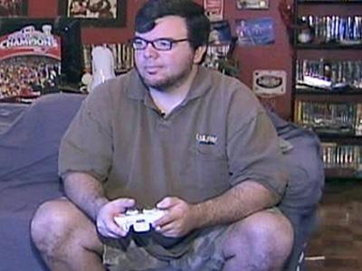 Video-game journalist John Gaudiosi spends some time in his Raleigh office playing with the games about which he plans to write.