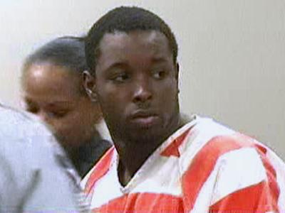DonJuan Cassadary Smith, charged with murder in the death of a 2-year-old boy, is led into a Wake County courtroom Friday, May 16, 2008.