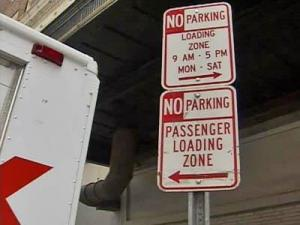 No parking sign, loading zone sign