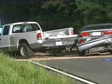 A pickup truck cross the center line and struck a Buick sedan in a three-vehicle wreck on Red Mill Road in Durham on Friday, May 16, 2008.