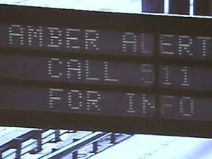 Overhead signs on state roadways only display a simple message about an Amber Alert and prompt motorists to call a number for more information.