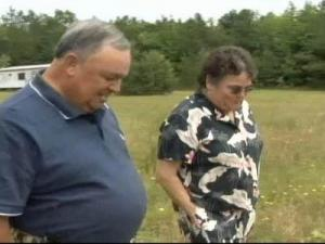 Siblings Bill Jones and Wanda Ramm walk across their family's land.
