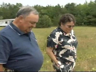 Siblings Bill Jones and Wanda Ramm walk across their family's land.