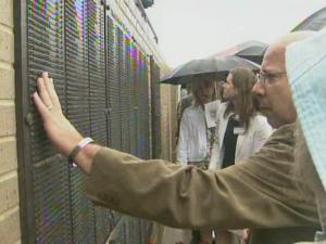 Family members of fallen Special Operations soldiers attend a May 28, 2008, ceremony at Fort Bragg in which the soldiers' names were added to a memorial wall.