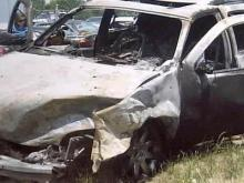 The GMC Yukon caught fire after another vehicle hit it Saturday on Highway 210 in Angier.