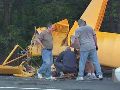 People survey the damage of a small plane crash along Interstate 85 on May 30, 2008.