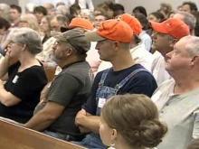 Dog tethering concerns tie up Orange County meeting