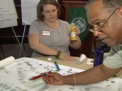 City leaders and residents go over the area's strengths and weaknesses.
