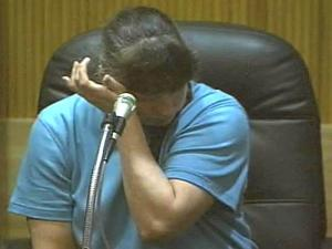 Lynn Paddock wipes away tears as she testifies in her murder trial on June 9, 2008.