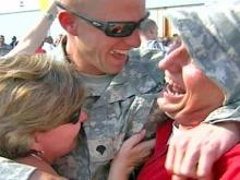Guardsmen fly home to tears, hugs and flags