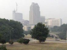 Smoke from an eastern North Carolina wildfire leaves a gray haze over downtown Raleigh on June 12, 2008.