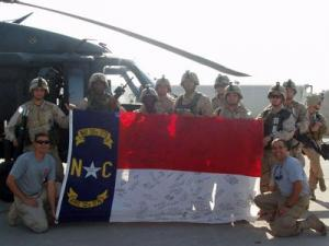 Richard Bucci brought a North Carolina flag to Mosul and had soldiers from the state sign it.