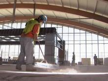 Construction crews put the finishing touches on the interior of Raleigh-Durham International Airport's Terminal 2, which is expected to open this fall.