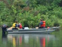 Divers search Carolina Lake for a suspect who slipped underneath the water while fleeing from police on Friday, June 20, 2008.