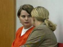 Joy Johnson confers with her attorney in District Court in Durham on Monday, July 7, 2008.