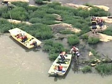 Emergency crews at the scene after finding a second body in the Neuse River on July 9, 2008.