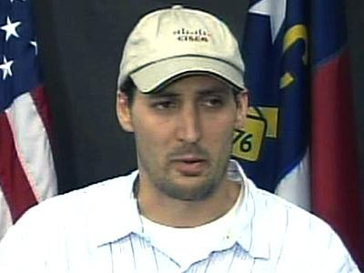 During a July 14, 2008, police news conference, Brad Cooper, Nancy Cooper's husband, thanks volunteers who searched and distributed fliers for his missing wife.
