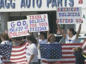 More than 200 military wives rally outside Fort Bragg on July 16, 2008.