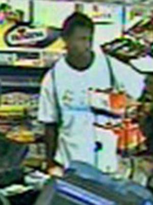 Surveillance cameras caught a man that might have been involved in a carjacking and robbery at convenience store at Millbrook Road and Atlantic Avenue in north Raleigh on Wednesday, July 16, 2008. (photos courtesy of the Raleigh Police Department)