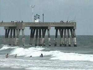 Swimmers stayed close to shore near a pier at Wrightsville Beach with Tropical Storm Cristobal approaching on Saturday, July 19, 2008.