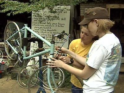 ReCYCLEry volunteers fix up an old bike.