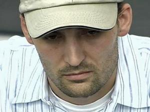 Nancy Cooper's husband, Brad Cooper, listens during a police news conference on July 14, 2008.