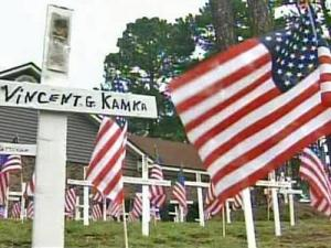 Crosses and American flags stand in the front yard of Barbara Morris' Fayetteville home as a memorial to each Fort Bragg soldier who has died in combat since Sept. 11, 2001.