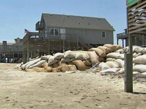 The Division of Coastal Management will be asking some residents to remove sandbags.