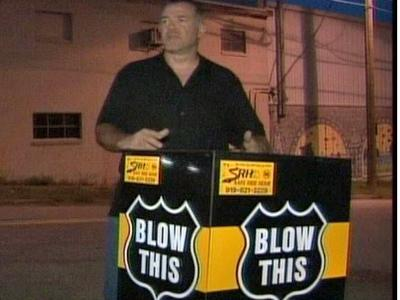"Doug Scott took the ""Blow This"" cart to downtown Raleigh on July 25, 2008. The cart has an alcohol breath tester."