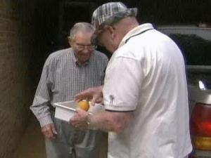 Robert Hardee, a Meals on Wheels volunteer, delivers food to a client.