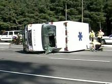 Ambulance flips while carrying patient