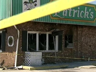 Yellow tape surrounds Patrick's Cafeteria in Kenley following a fire that destroyed the restaurant's inside. Dale Moore, who owns the family-run business, says he plans to rebuild.