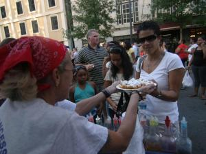 Joan Brooks grabs a fresh funnel cake during the 2008 Raleigh Wide Open event.