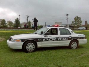 Police stand at the scene where an Amtrak train hit and killed a woman on Tuesday, Sept. 9, 2008. (Photo by Erin Coleman)