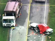 A state Highway Patrol cruiser and a garbage truck collided on Ten-Ten Road south of Raleigh on Sept. 9, 2008.