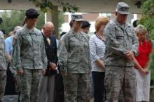 An audience of North Carolina National Guard soldiers, airmen and civilians  bowed their heads as Major Gen. William E. Ingram, Jr., adjutant general of the N.C. National Guard, gave sobering remarks about the heightened level of security Americans and North Carolinians must endure during a Patriot Day Ceremony at the Claude T. Bowers National Guard Complex Sept. 11, 2008. The ceremony honored those lost and injured during the event, as well as National Guard soldiers lost since the attack during the Global War on Terror.  (NCNG photo By Tech. Sgt. Stephen R. Wilkins)