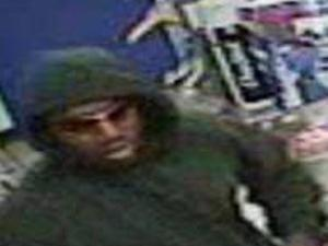 A surveillance image of the suspect in the May 24, 2008 robbery of the Capital Food mart. (Courtesy of the Raleigh Police Department)